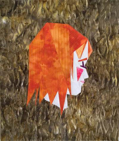 Quilt Art of a girl with red hair on a brown background