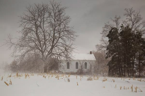 Sepia toned photograph of old church in rural setting