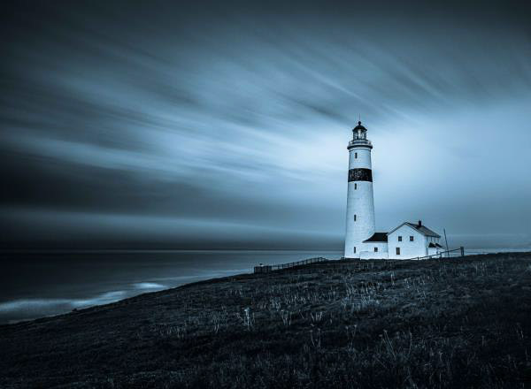 Blue Monocramatic photograph of a lighthouse