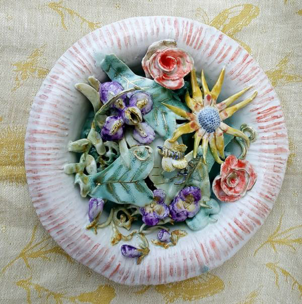 Porcelain piece of a plate with a mixture of porcelain flowers and leaves