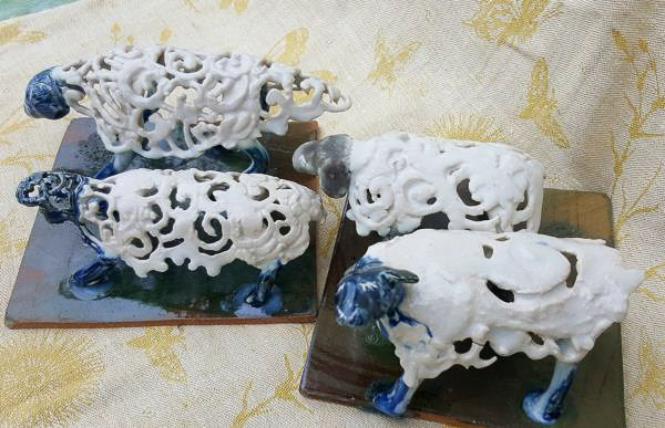 Porcelain sculptures of curly spring lambs