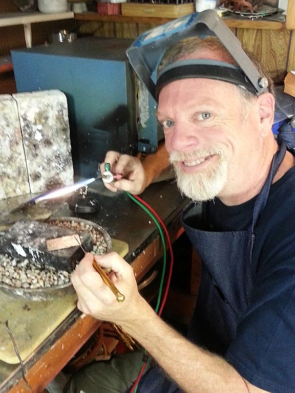 Charles Funnell, jewelry and metal artist, at work in his Cobourg studio.
